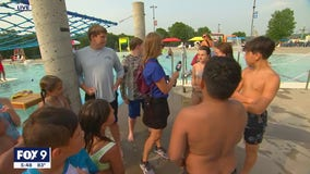 Kids hit the pool during Town Ball Tour in Faribault