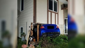 Man learning to drive stick shift crashes car into St. Paul home