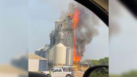Farmers, local workers join firefighters to battle large grain elevator fire in Clinton, Minn.