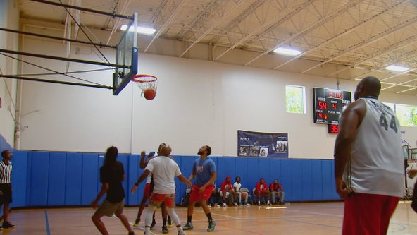 Community group hosts basketball game to build bonds with police in Hopkins, Minn.