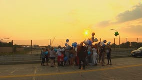Family releases balloons to remember baby killed in Brooklyn Center crash