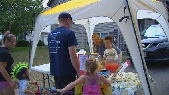 Boy holds lemonade stand to help support Farmington Police K-9