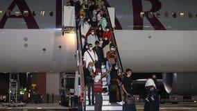 Afghan evacuee flights paused for 1 week amid more measles cases