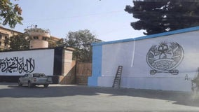 Taliban paints its flag on outside wall of what was US embassy in Kabul