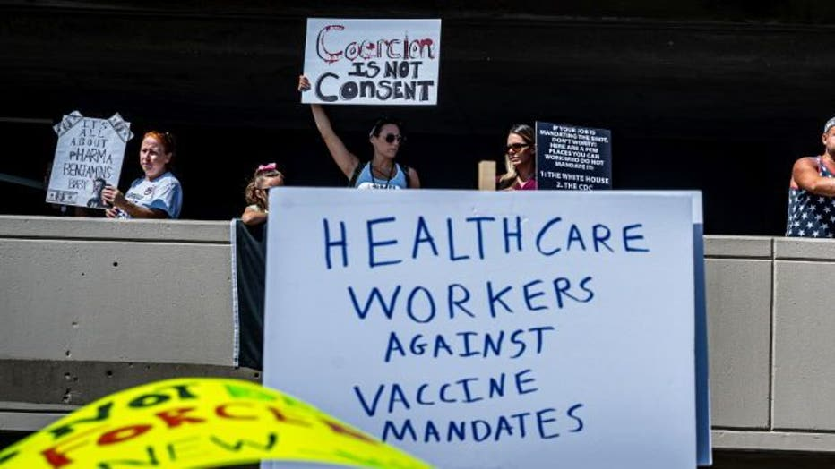 f694007e-Healthcare workers unite against mandated vaccines at Stony Brook Hospital on Long Island