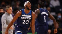 Edwards, KAT lead Wolves to 124-106 win over Rockets to open season