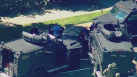 Carjacker surrenders after wild pursuit with PIT maneuvers, armed standoff