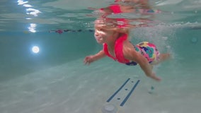 Children receive swim lessons to prevent summer tragedies