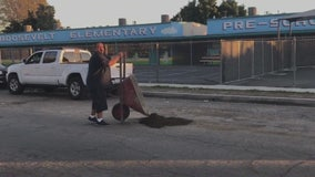 Compton family pitches in to repair potholes on street