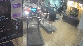 Car crashes through gym pinning man between treadmill and wall