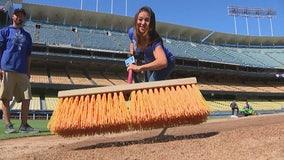 Ground crews prepare Dodger Stadium for Game 3 of NLCS
