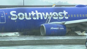 Southwest airplane slides off runway during heavy rain in Burbank