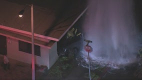 Truck slams into fire hydrant and apartment building in Bell