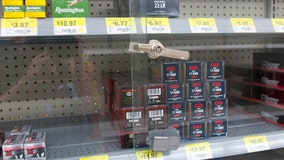 Walmart pulls violent game displays but will still sell guns
