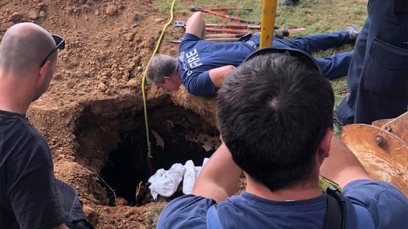 Woman rescued after falling into septic tank, lying in raw sewage for days, officials say