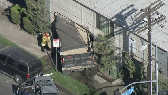 Dump truck crashes into apartment building in Pacoima