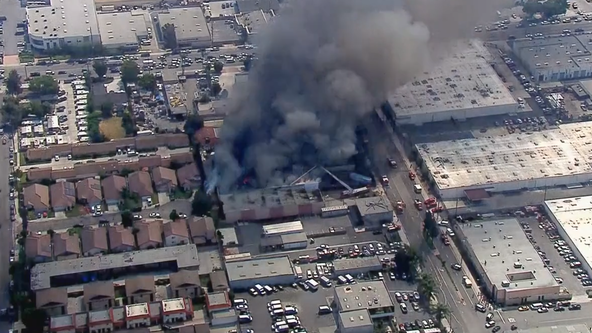 Crews battling commercial building fire in Paramount
