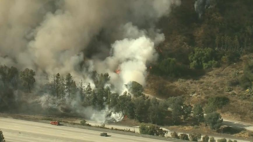 Fire crews battle large brush fire near Eagle Rock
