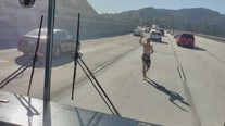 VIDEO: Nearly naked man tries forcing his way onto school bus on 5 Fwy.