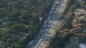 Big rig carrying crane overturns, closing all EB lanes on 210 freeway in La Canada Flintridge