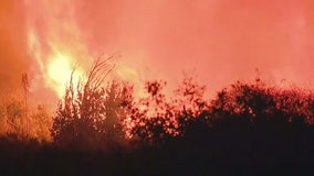 Crews battling rapidly spreading vegetation fire in La Cresta