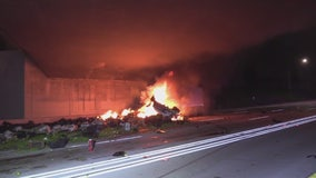 Big rig crashes in Anaheim, catches fire, driver hospitalized