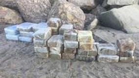 Beached panga carrying dozens of bales of marijuana located in Malibu