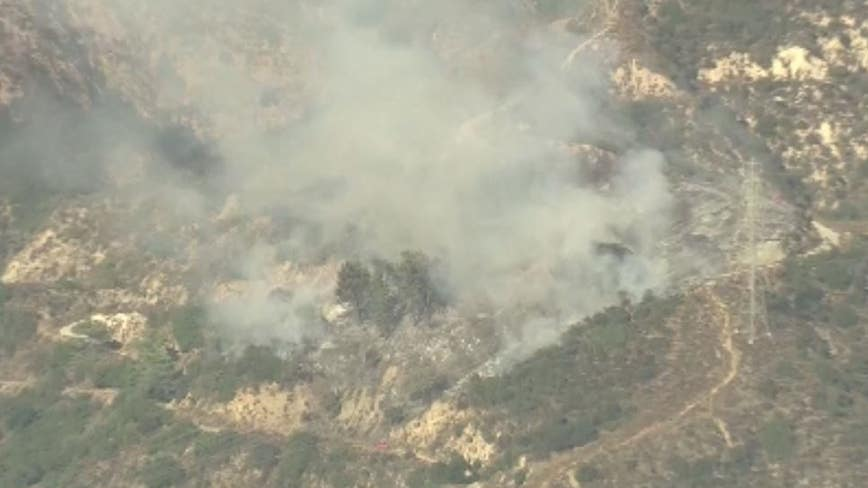 Fire crews battle blaze in Angeles National Forest near Altadena