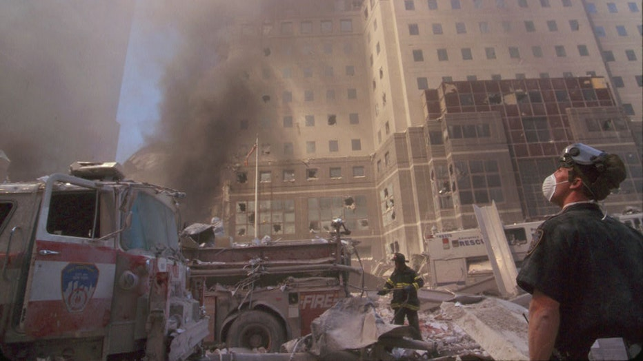 A first responder looks up during rescue efforts during the 9/11 terror attacks on the Twin Towers. Photograph is from 8 rolls of unedited film taken by an anonymous photojournalist at ground zero that day.