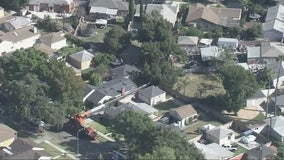 Crane topples over  in Long Beach neighborhood