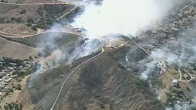 Fire crews work to knock down terrain-driven fire near East L.A.