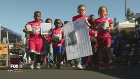 NFL players pay it forward for Compton youth football team