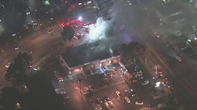 Man killed, woman critically injured after fire tears through Pico Rivera strip mall