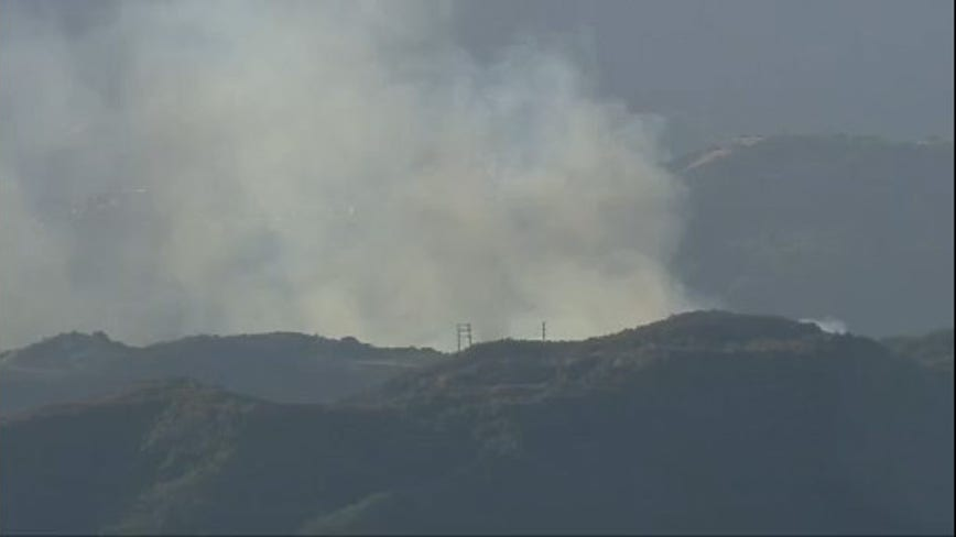 Firefighters quickly contain brush fire that sparked along Topanga Canyon
