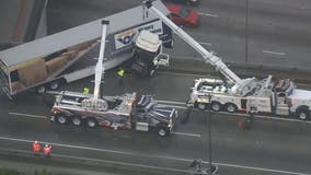 Big rig dangles off connector ramp on 710 Freeway during morning rush hour on rainy day