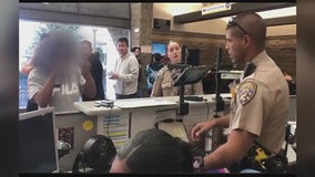 CHP officer uses sign language  to help woman at DMV office