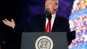 Defiant Trump rallies supporters during impeachment vote
