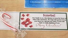 Boy's adorable candy-cane gram shows love for exhausted retail workers during busy holiday season