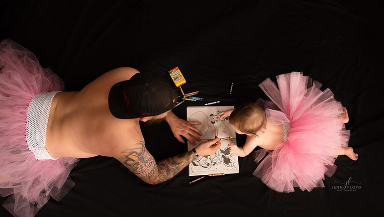 Casey and Lyla captured coloring in a daddy-daughter photoshoot.