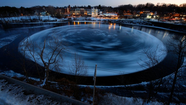 WESTBROOK, ME - JANUARY 14: This 30-second exposure shows a circular ice floe spining counter-clockwise in the Presumpscot River below Bridge Street, as viewed from a nearby parking garage. (Staff photo by Ben McCanna/Portland Portland Press Herald via Getty Images)