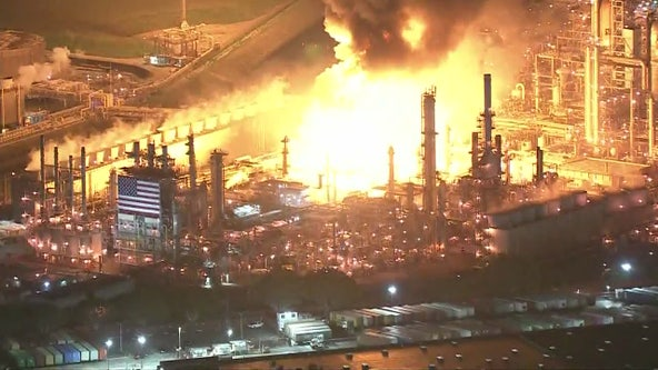 Massive fire at oil refinery in Carson contained after explosion, officials monitoring air quality