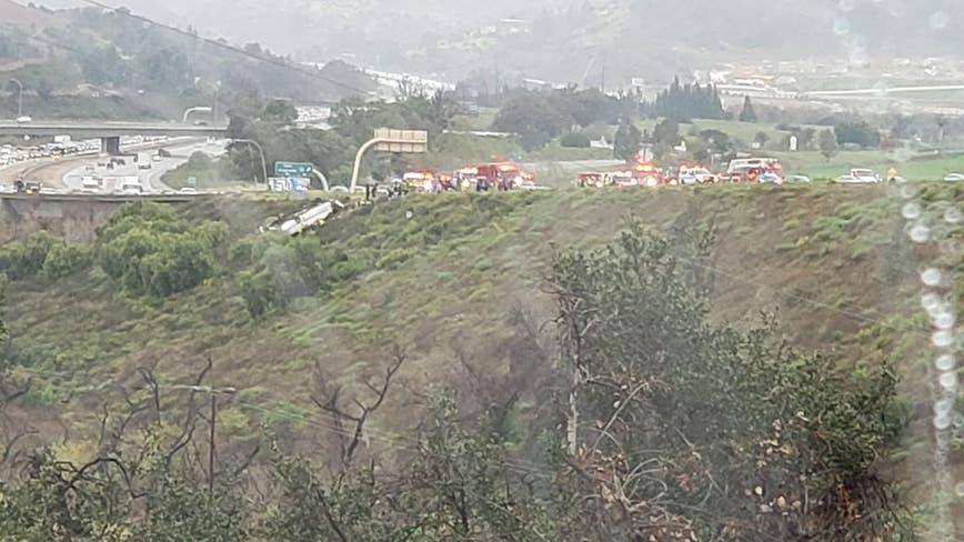 3 dead, 18 injured after bus rolls over on 15 Freeway in San Diego County