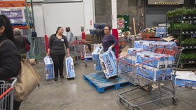 Mass crowds rush to local stores to stockpile goods amid coronavirus concerns