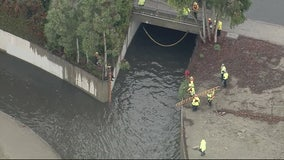 2 people trapped in Lakewood drainage canal, rescue underway