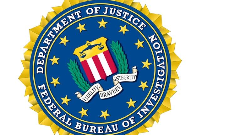 117a8553-FBI-Federal_Bureau_of_Investigation-seal_1542319823687-402429.jpg