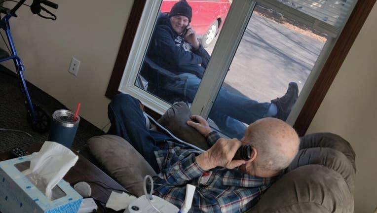 nursing home visit through window