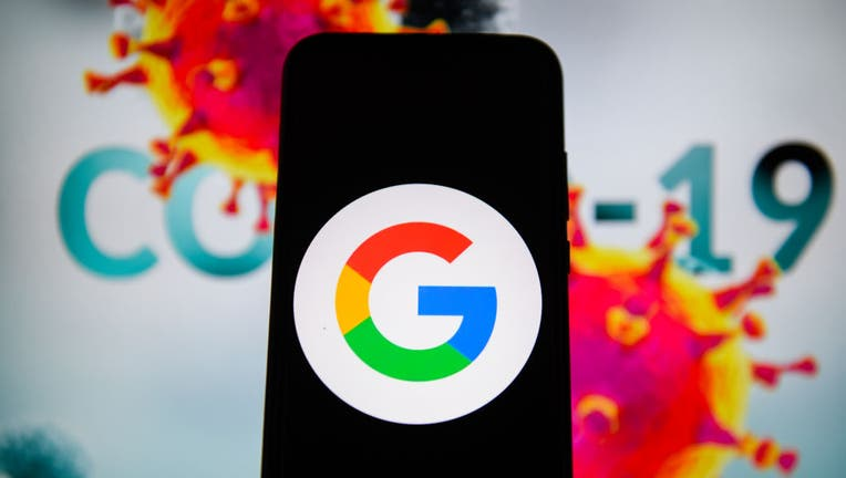 In this photo illustration a Google logo is seen displayed