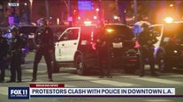 Protesters clash with police in downtown LA