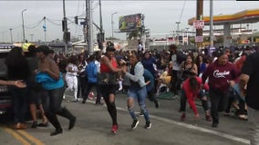 Crowd breaks through police barriers during Nipsey Hussle procession