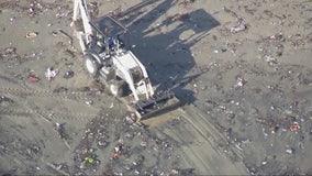 Trash lines shore following rain storms in Seal Beach